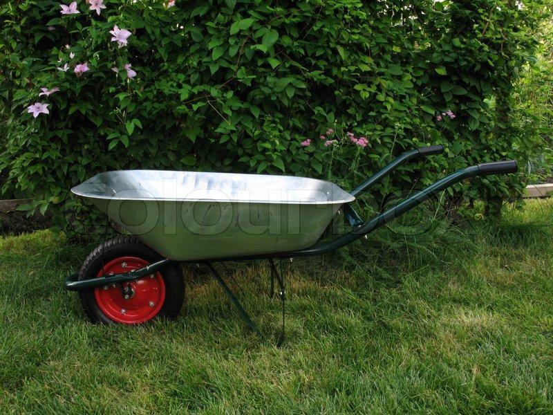 ... New Wheelbarrow On Green Grass In Garden ...