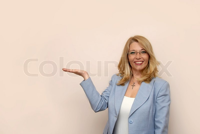 Blond Businesswoman In Glasses Showing Stock Image