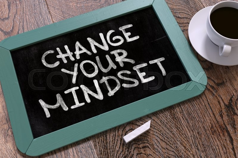Change Your Mindset. Motivation Quote Hand Drawn on Blue Chalkboard on Wooden Table. Business Background. Top View, stock photo