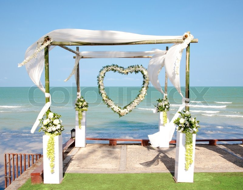 Image of 'Wedding arch with flowers decoration on the beach'