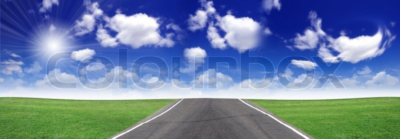Road and green field, stock photo