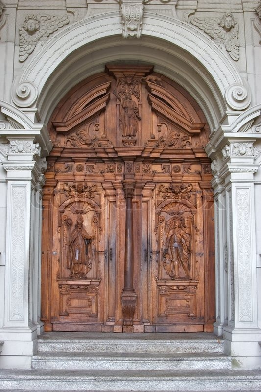 Wooden Doors Of A Cathedral In Lucerne Decorated By