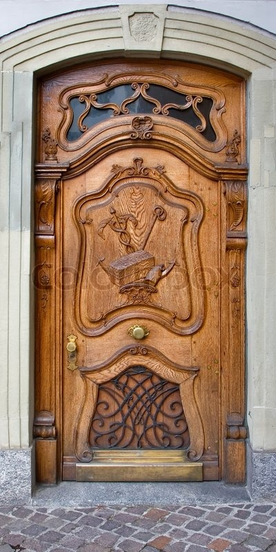 Richly Decorated Antique Wooden Door Stock Photo Colourbox
