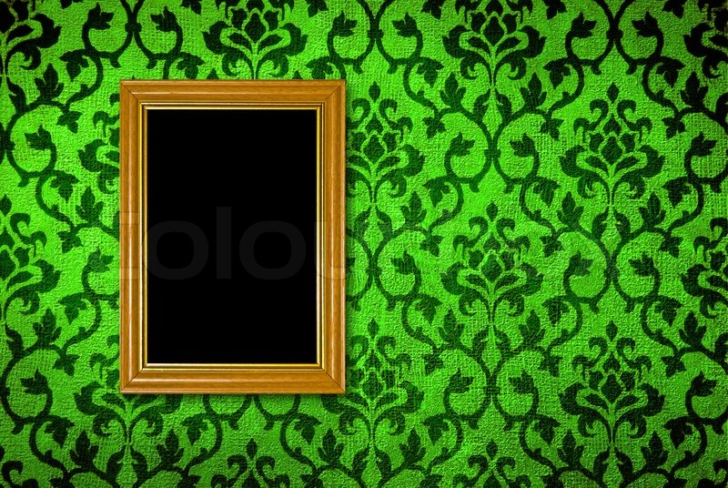Gold frame on a vintage green wall background, stock photo