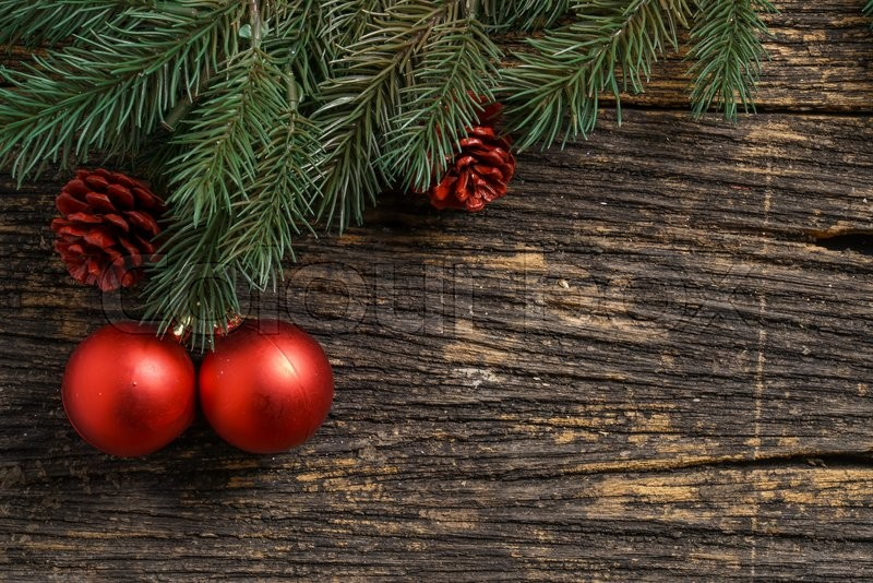 Still life of christmas ornament and tree branch on wooden board, stock photo
