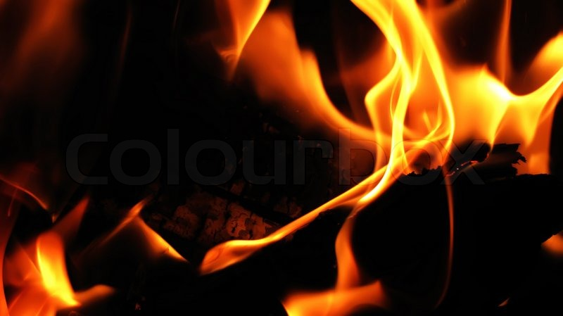 Burning Fire Wood In A Hot Flame Of A Night Fire Stock