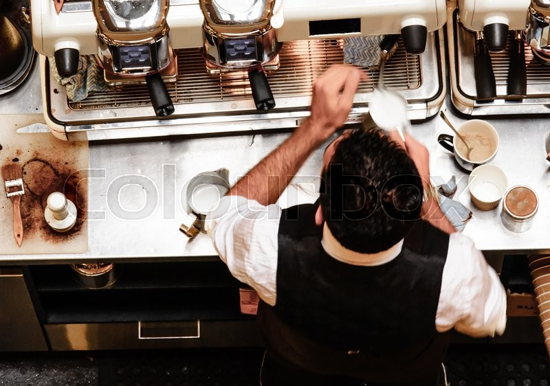 Barista and coffee machines at the bar, vintage filter applied, stock photo