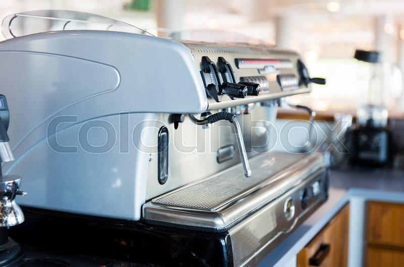 Equipment, object and technology concept - close up of coffee machine at bar or restaurant kitchen, stock photo