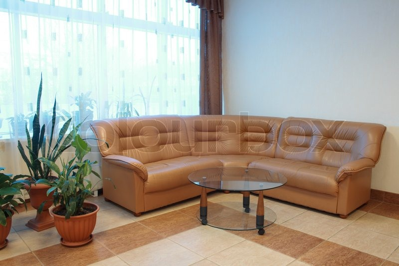 Nice home interior with brown leather sofa and round glass Nice house interior