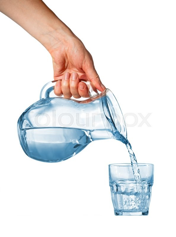 hand pouring water from glass pitcher to glass over white background