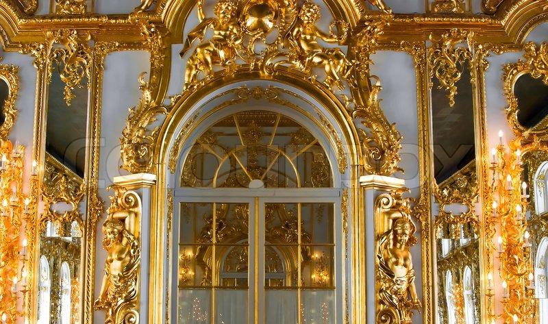Beautiful wall with large door, golden candelabras and ...