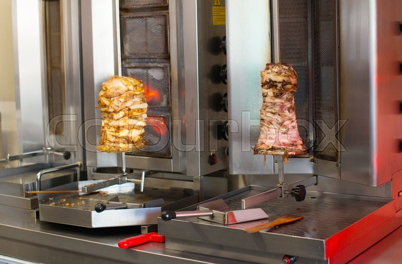 Pita gyros preparation on the kitchen in street cafe, stock photo