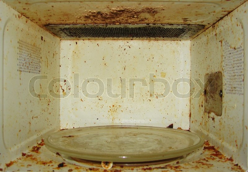 Dirty Microwave Oven ~ Dirty microwave with burnt paint on the walls stock