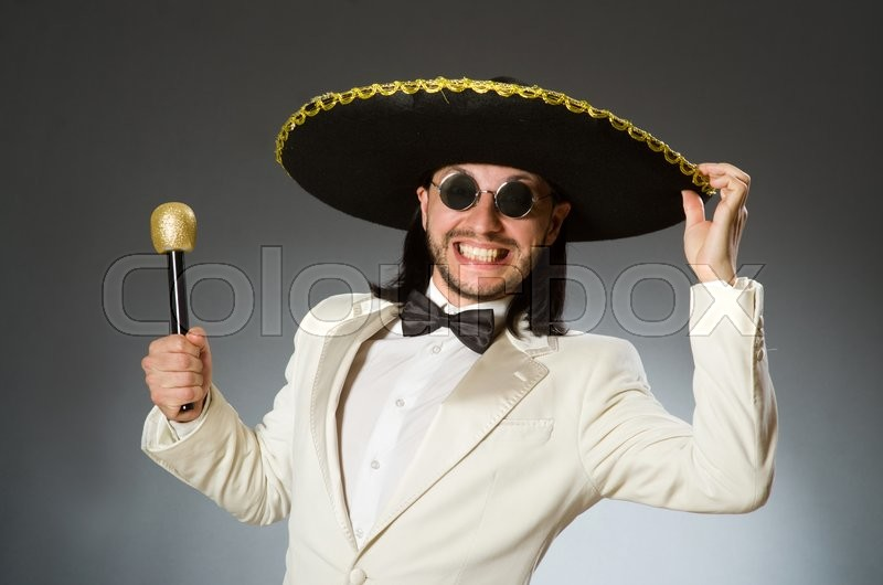 Person wearing sombrero hat in funny concept, stock photo
