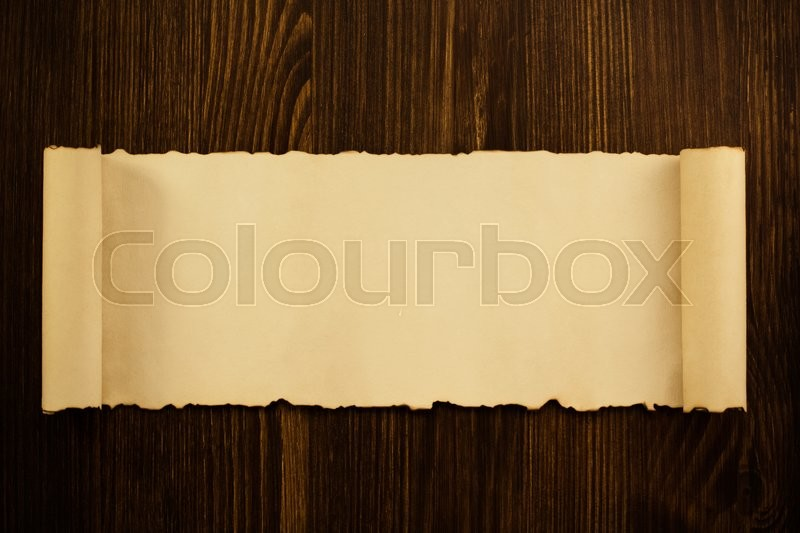Parchment scroll on wooden background, stock photo