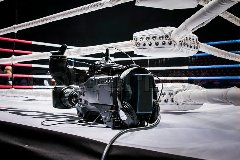 Professional camcorder stands on corner ring for mixed martial arts. live broadcast competition in MMA and Boxing, stock photo