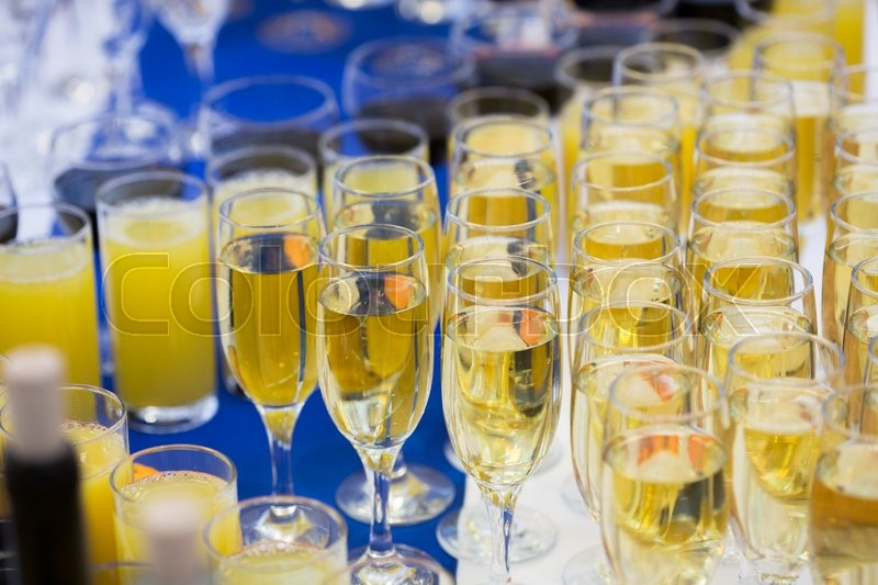 Glasses with champagne on the party table. lot of alcohol, stock photo