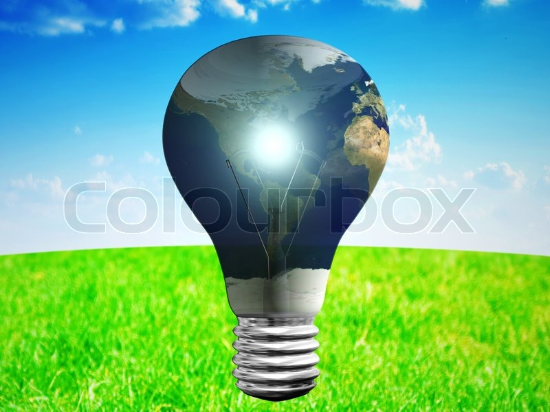 Light bulb with earth map at blue sky and green grass backgrouund, stock photo