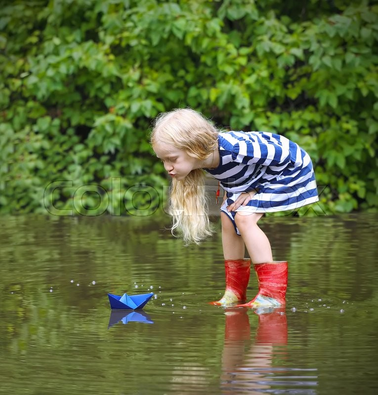 Happy Beautiful Natural Emotion Woman Joying On Blue Sea: Girl With Blue Paper Boat In A Puddle ...