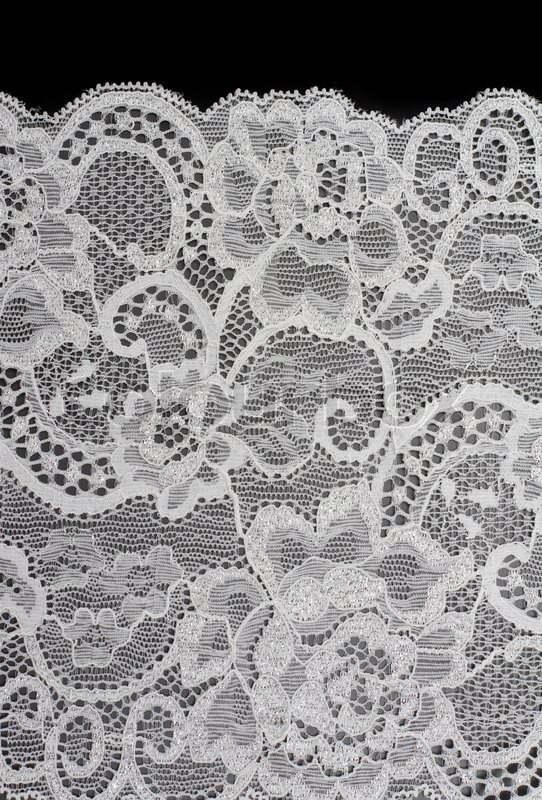 Stock image of 'Decorative white lace with pattern on black background'