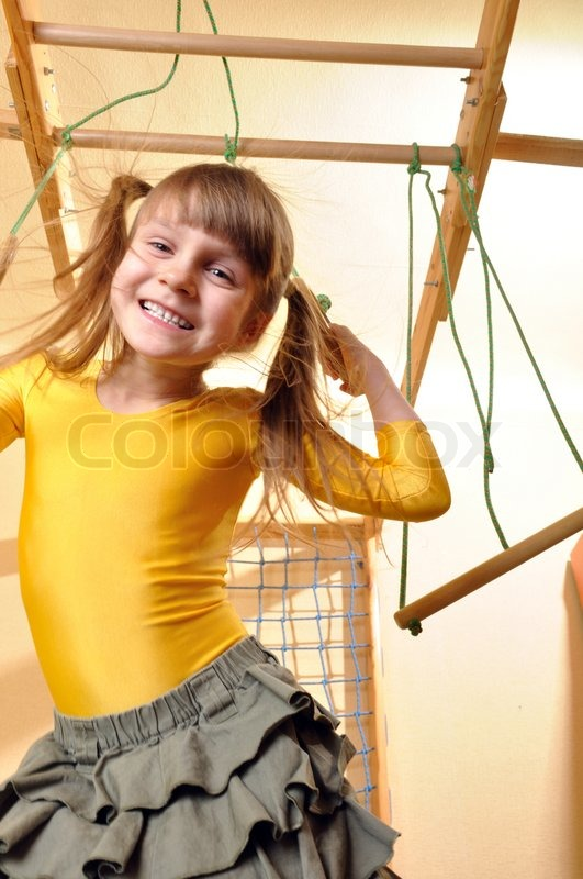 6 Year Old Girl Playing At Her Home Stock Photo
