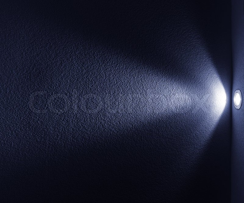 blue light beam from projector on black background stock