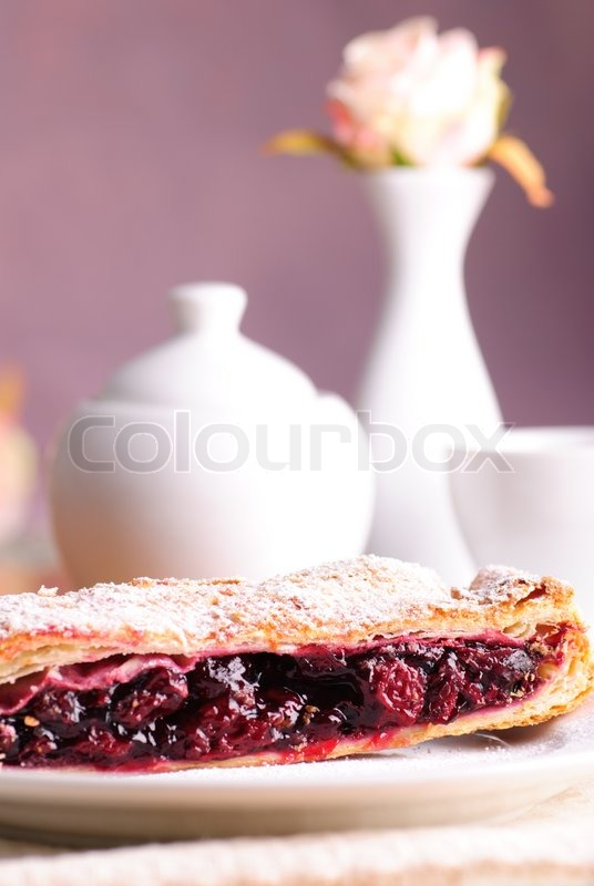 Stock image of 'Cherry strudel with white dishes close up'