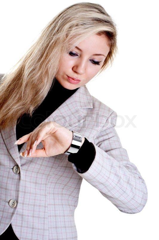 Armbanduhr am arm frau  Frau schaut auf die Uhr auf einem weißen Hintergrund | Stockfoto ...