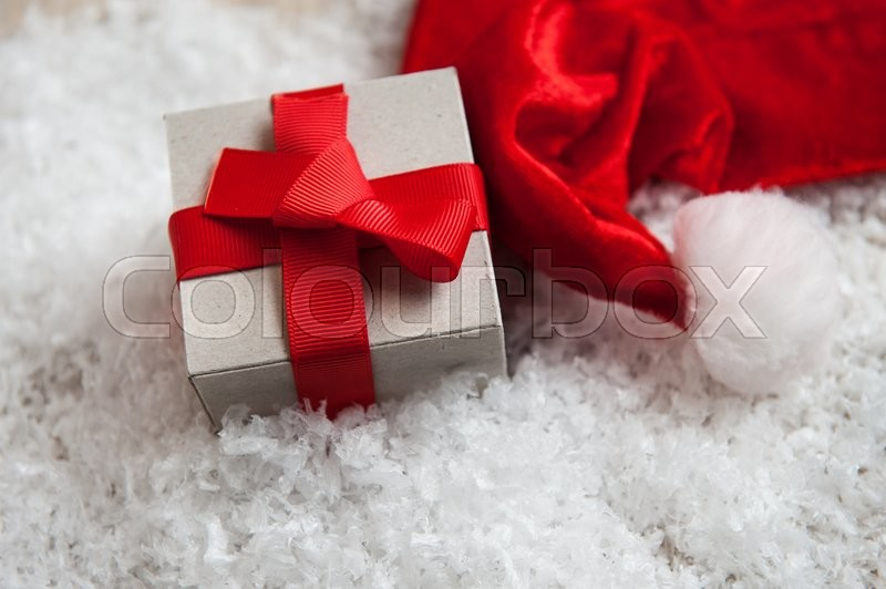 Box of kraft paper from the hat of Santa Claus in the snow, stock photo