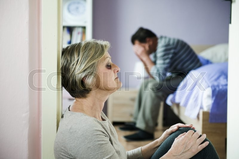 Mature woman with black eye is victim of domestic violence and abuse, stock photo