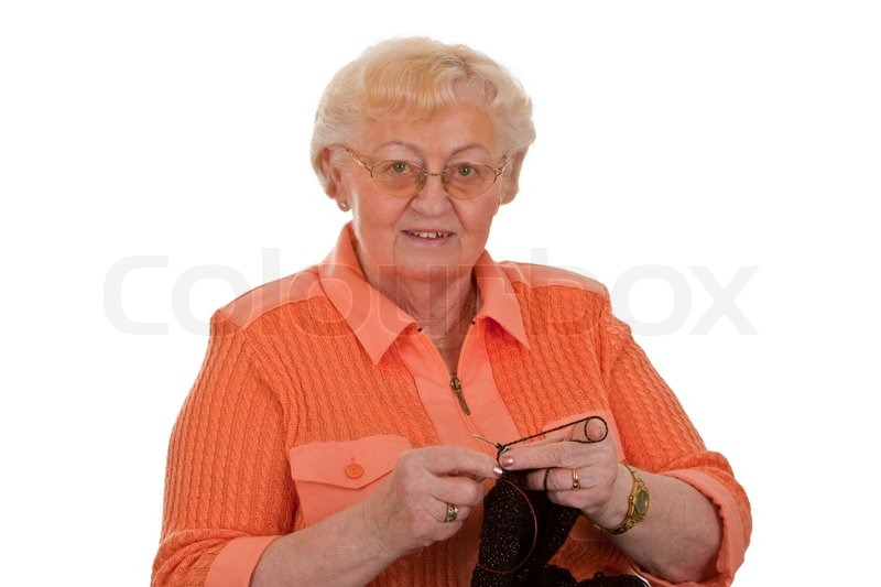 Get Knitting Grandma : Old woman senior is knitting isolated on white background
