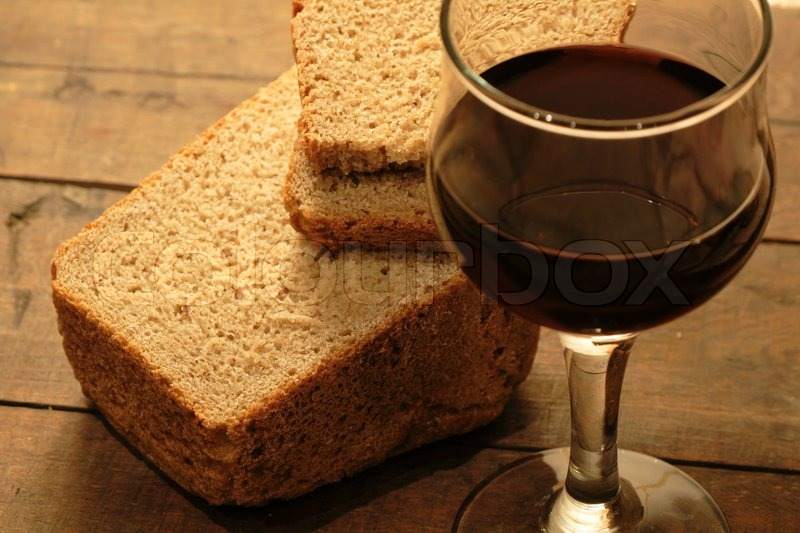 closeup of rye bread and goblet of red stock photo