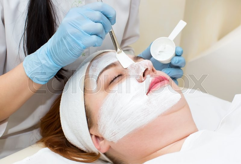 Cosmetic treatment with injection in a clinic, stock photo