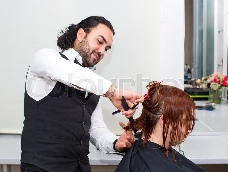 Hairdresser makes hair woman in a beauty salon, stock photo