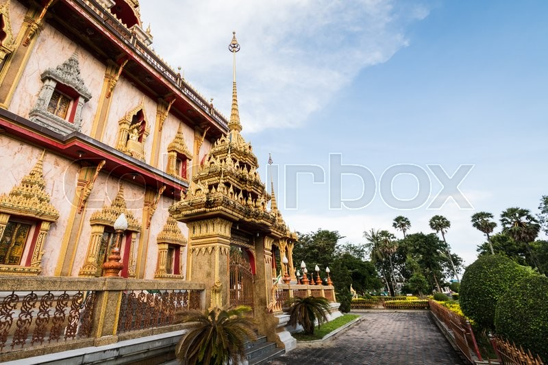 Thai style outdoor architecture with sculpture under sunlight in chalong temple, Phuket, Thailand, stock photo