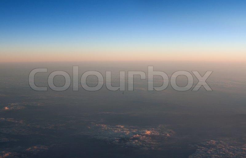 Type sky from plane, blue sky horizon line, stock photo