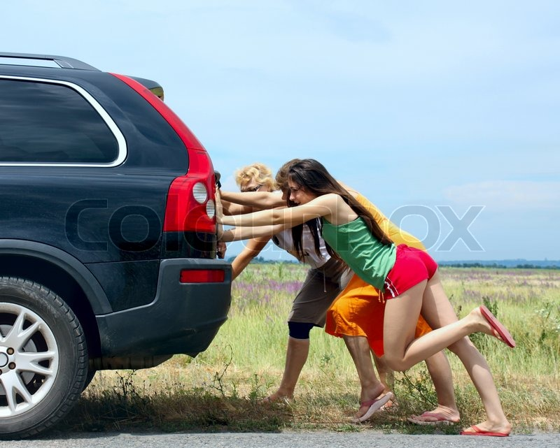 three girls push the broken car stock photo colourbox
