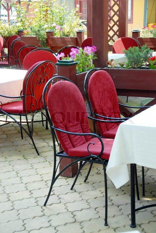 restaurant terrasse mit metallischen st hle und tische im freien stockfoto colourbox. Black Bedroom Furniture Sets. Home Design Ideas