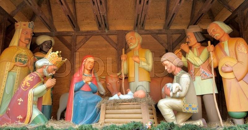 stock image of christmas manger scene with figurines including jesus mary joseph