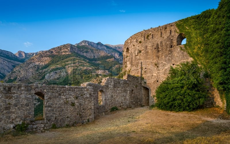 Medieval fortress stone walls and mountain range. Town of Bar, Montenegro, stock photo