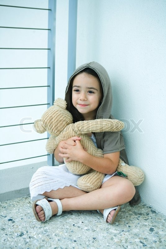 toddler girl with brown hair and brown eyes