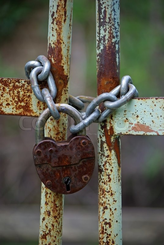 Old Rusty Gates Closed Wiyh Chain And Padlock Stock