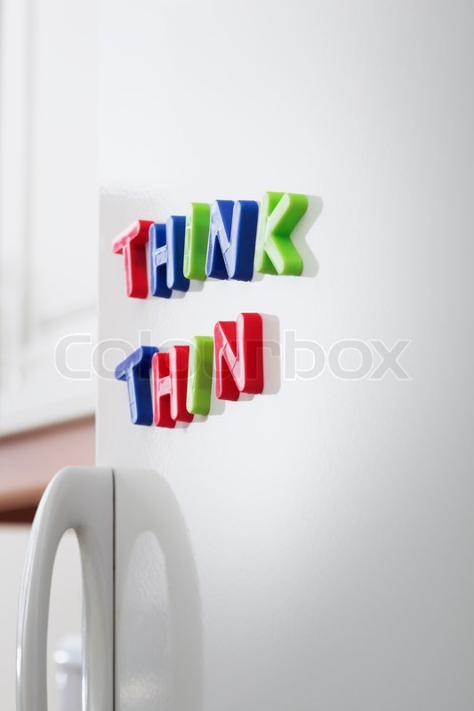 Words THINK THIN magnets on a       Stock image   Colourbox