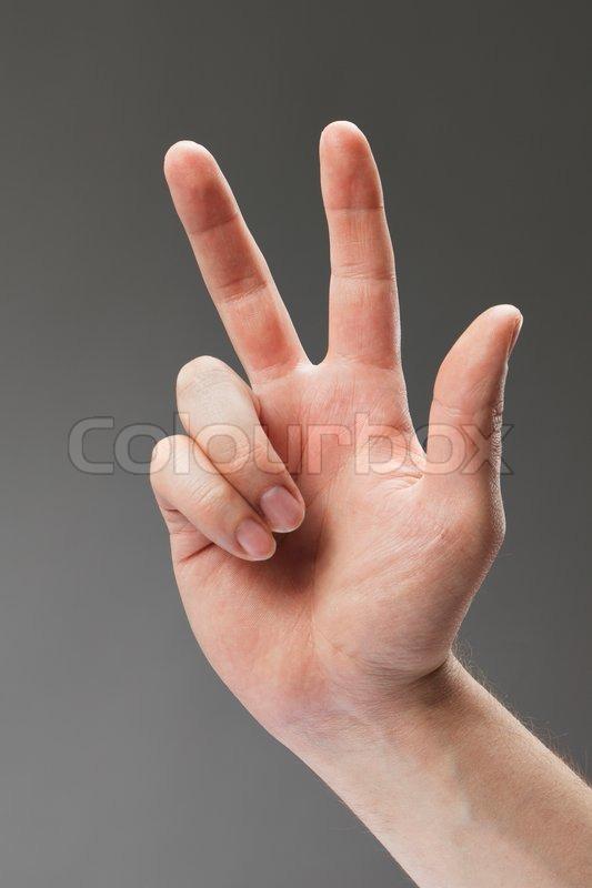 Hand eines Mannes mit drei Finger zeigen | Stockfoto | Colourbox
