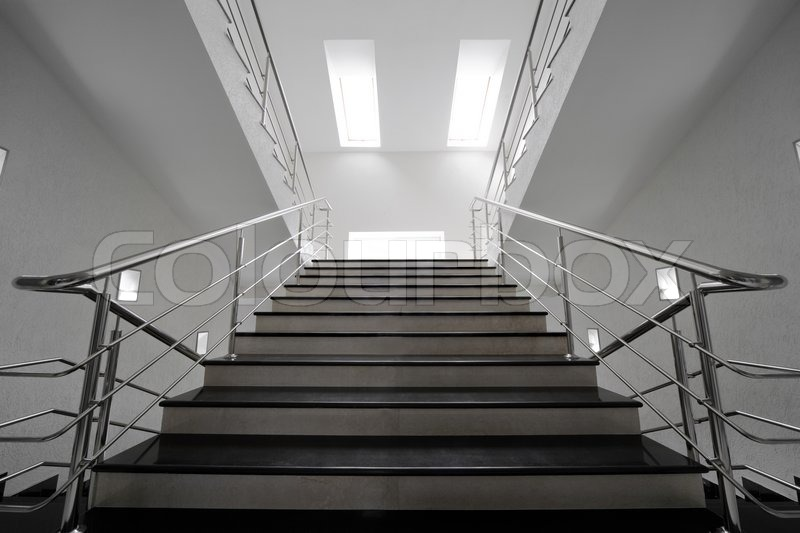 Marble Staircase With A Steel Handrail In A Modern