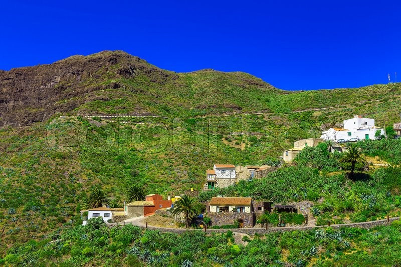 Small Village and Buildings in Green Mountains Landscape on Canary Island, stock photo
