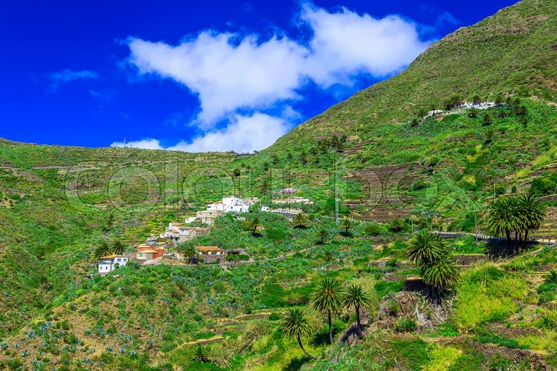 Small Village and Buildings in Green Mountains Landscape on Tenerife Island in Spain, stock photo