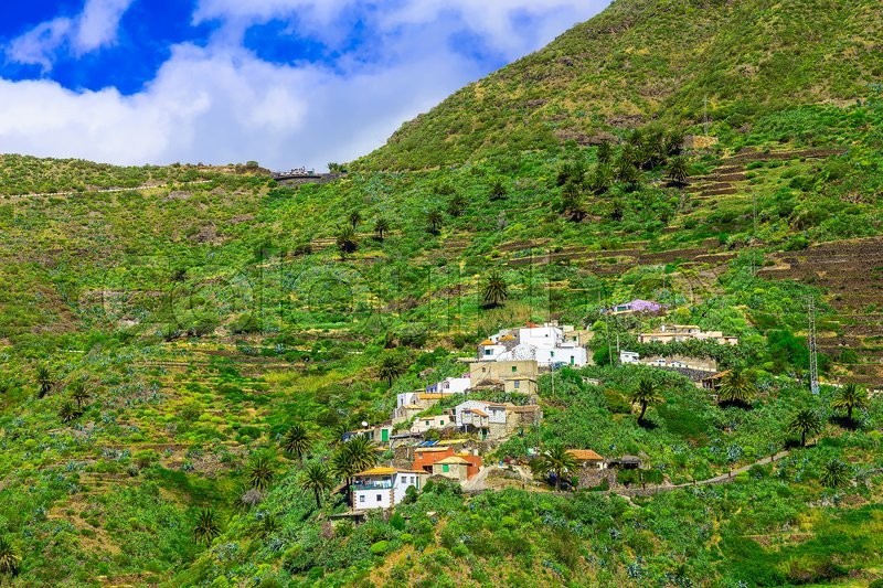 Small Village and Buildings in Green Mountains Landscape on Canary Island in Spain, stock photo