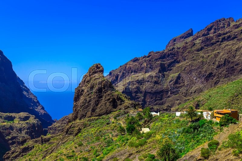 Small Village and Buildings in Green Mountains Landscape on Tenerife Canary Island, stock photo