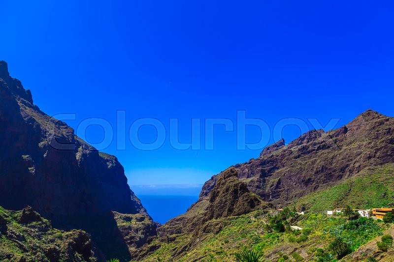 Small Village and Buildings in Green Mountains Landscape on Tenerife Island, stock photo